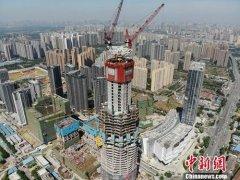 中国今年预计实际GDP增速为6.6% 较去