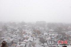 北京迎来今冬第二场降雪 不少市民